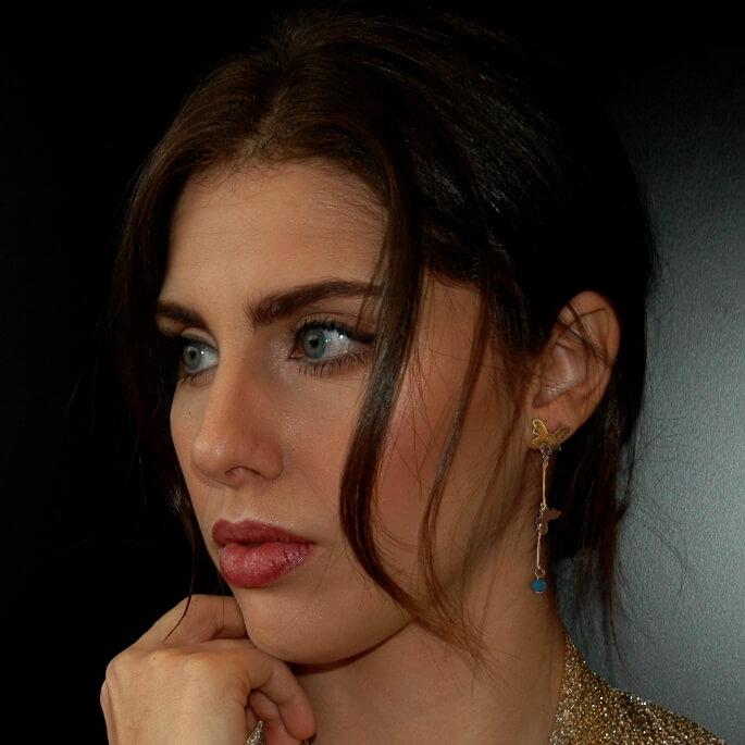 Long butterlies earrings on a model, by TH Jewels